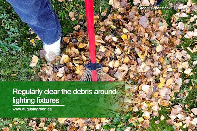 Regularly clear the debris around lighting fixtures